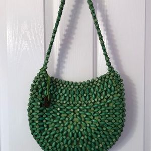 "Green ""Samoa grass"" purse by The Sak"